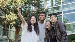 A group of international students taking a selfie at UCOL