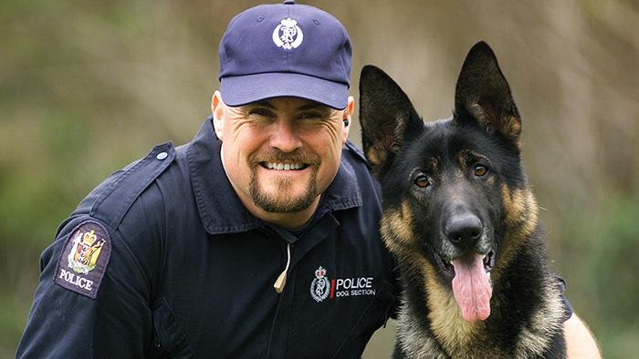 A photograph of a New Zealand policeman and his dog