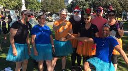 A photograph of UCOL staff dressed in tutus participating in Square Dash in 2017