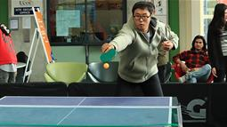 A photograph of a student playing table tennis at UCOL