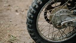 A close up photograph of a motorbike wheel