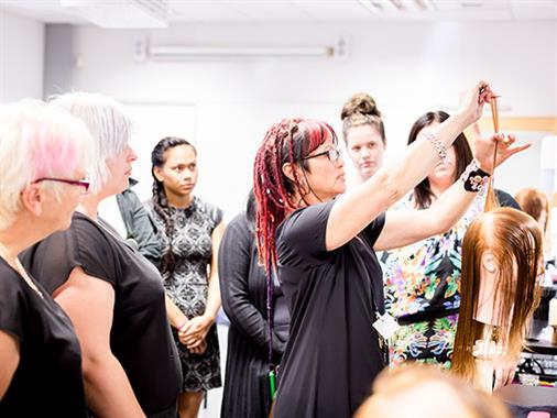 A photograph of a hairdressing training class