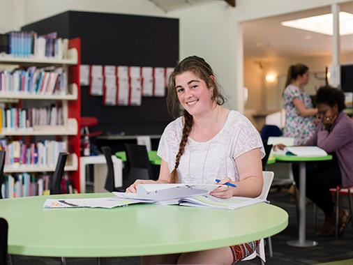 A photograph of a student in a library