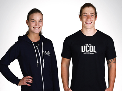 A photograph of two UCOL students wearing branded clothing.