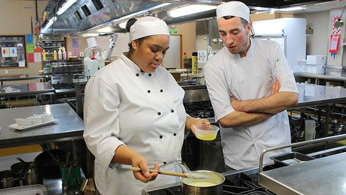 Chef Training and Hospitality students in kitchen