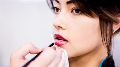 Lipstick application in UCOL's Beauty facilities