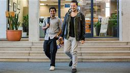 Two guys walk in front of UCOL's Information Centre in Palmerston North