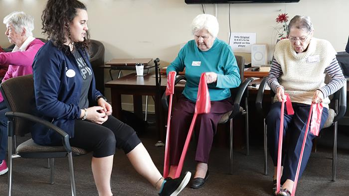 Students run exercise classes for Metlife residents
