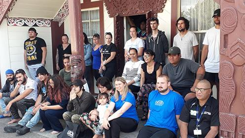 A photograph of a group of people at a Marae for a UCOL hui