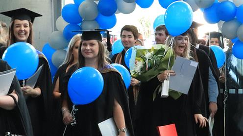 A photograph of UCOL graduates enjoying the parade in Palmerston North