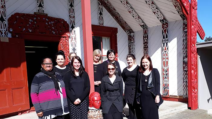 UCOL nursing students standing in front of Papawai Marae in Greytown
