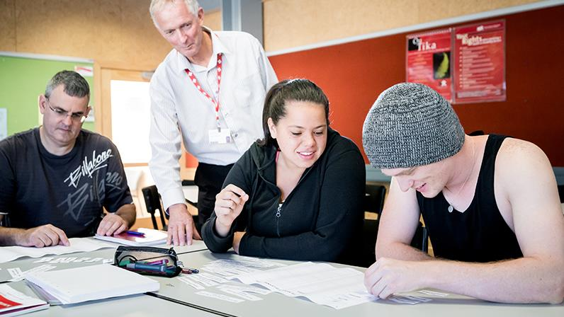 Business students work together with their lecturer at the Whanganui campus