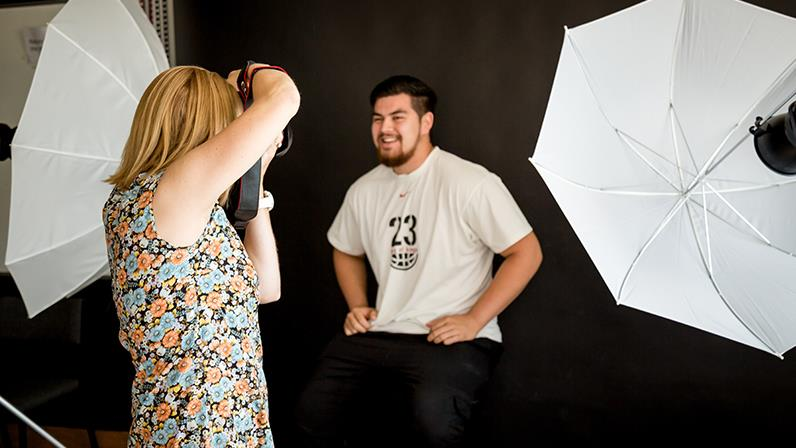 Students photograph each other in the studio at the School of Photography, Arts and Design