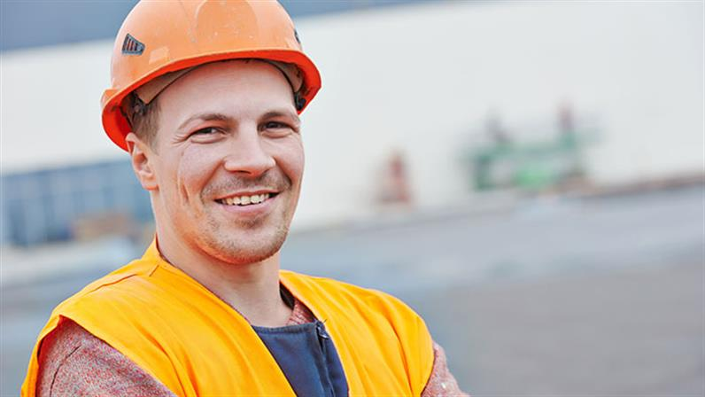 A photograph of a man in a hard hat.