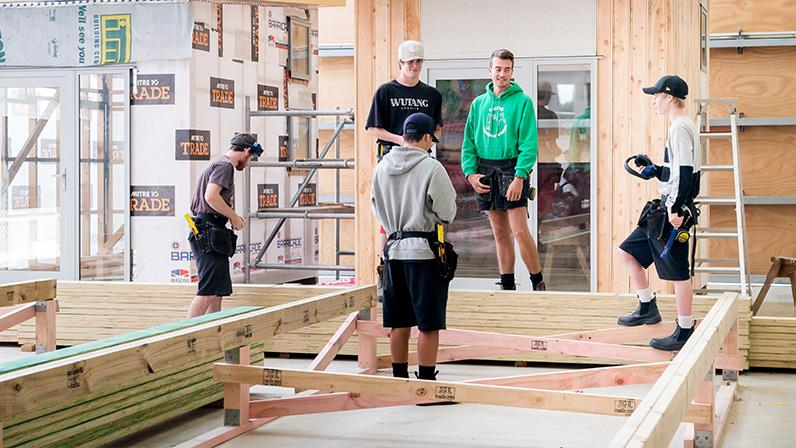 Carpentry students building a house inside our Regional Trades and Technology Centre at our Palmerston North Campus