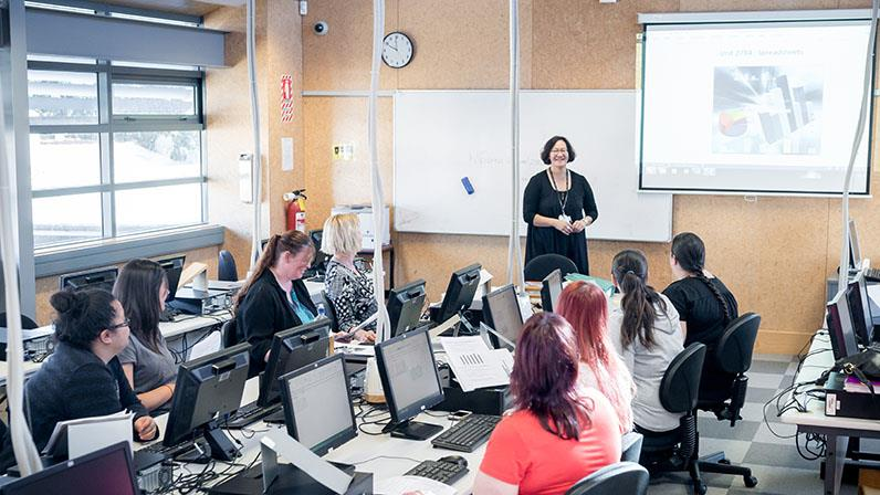 A photograph of a class of students at computers