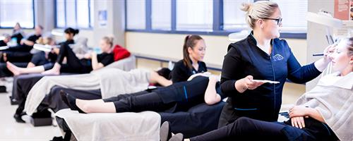 A photograph of UCOL beauty students performing services on clients in the salon