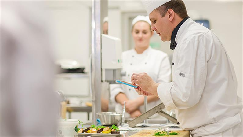 A photograph of a UCOL chef training lecturer leading a class