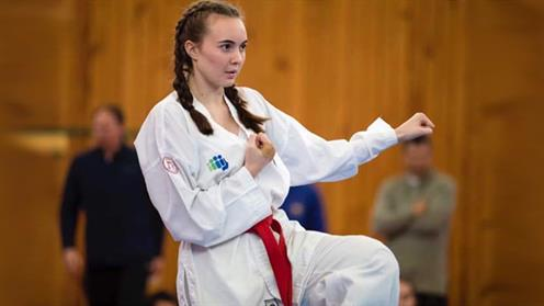 A photograph of UCOL Student Bree Hooper-Whiti performing Taekwon-Do.