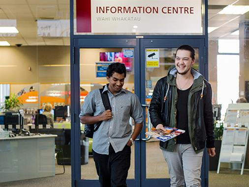 Two people at UCOL's Information Centre