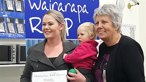 A photograph of UCOL student Tabitha Ayre receiving an award from Masterton Mayor Lyn Patterson