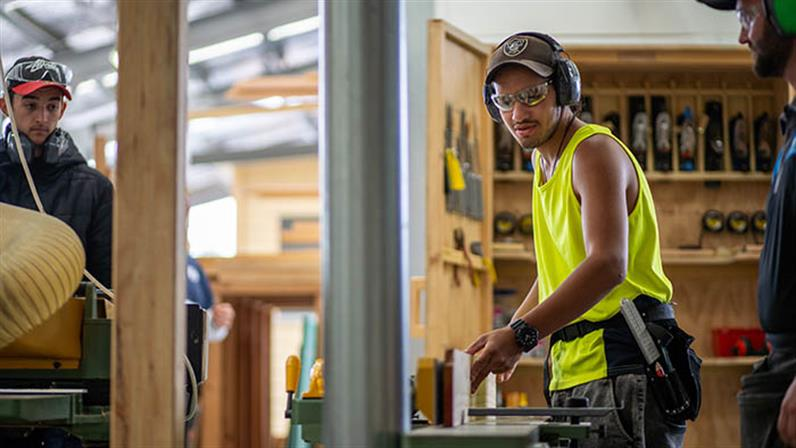 A carpentry student works on a door frame at UCOL in Palmerston North