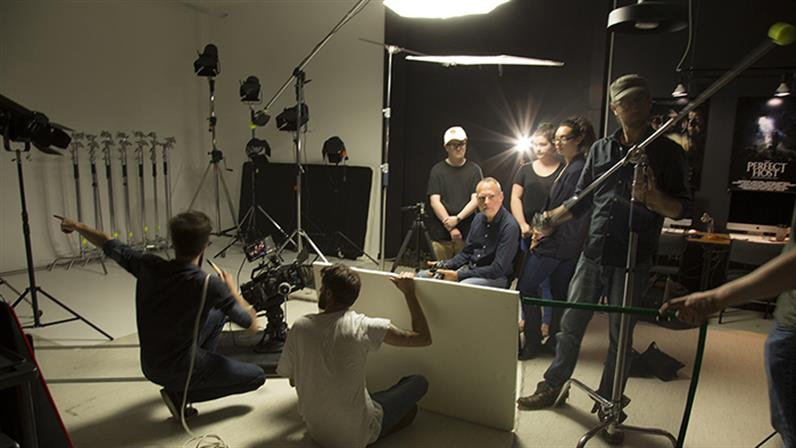 A photograph of people on set creating a video