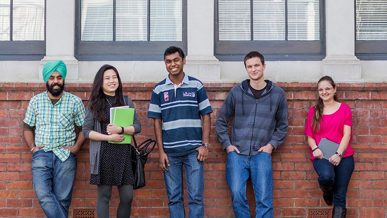 International students pose outside the Palmerston North campus