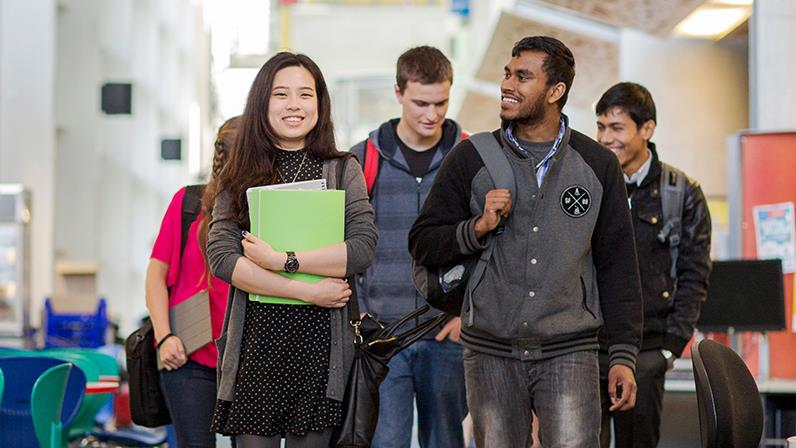 International students walk together in the Palmerston North atrium