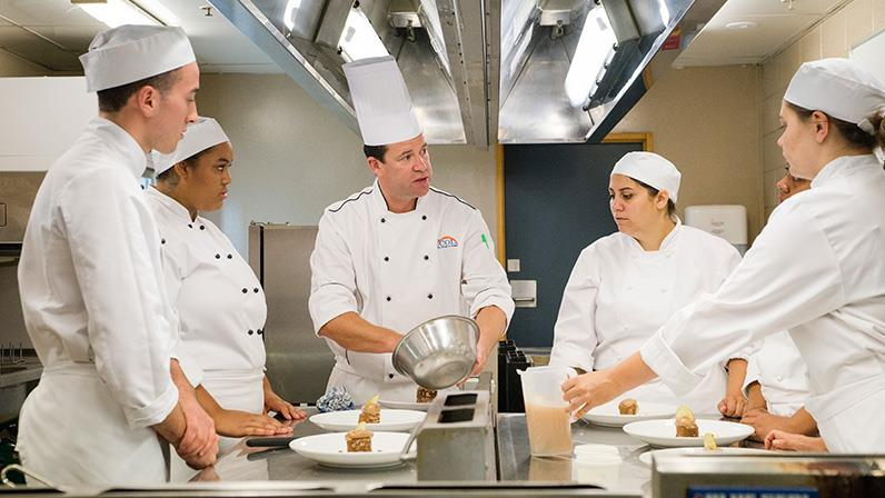 What are some of the top cooking schools in New Zealand?