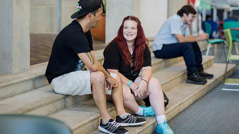 Students chatting in the Palmerston North atrium