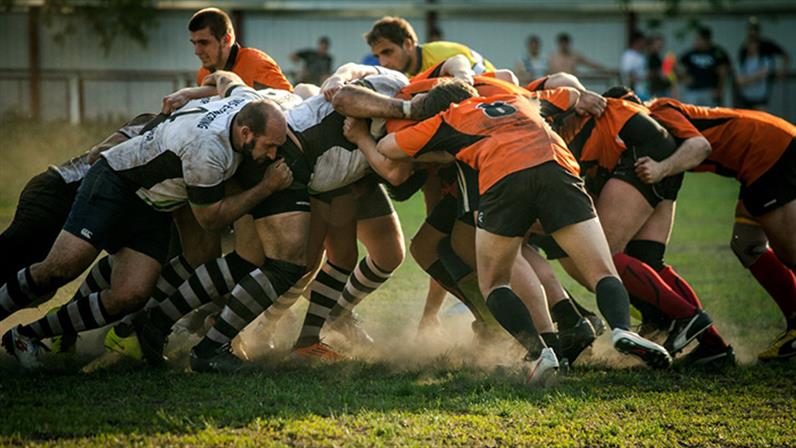 A photograph of a rugby scrum