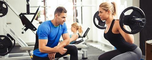 310d461221d A photograph of a trainer working with a client exercising
