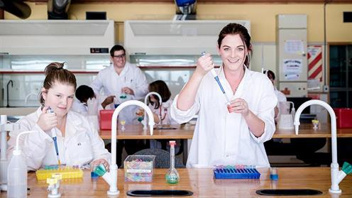 A photograph of students conducting experiments in a UCOL science lab